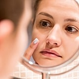 """The Many Stages of a Spot Now that we understand what triggers breakouts, we can look at the stages of a spot.  In the first stage, the pimple forms deep under the skin. """"All of our pores contain a hair follicle and a sebaceous gland that empties into it producing sebum, our skin's natural oil,"""" said Dr. Lee. """"The body is constantly regenerating and shedding dead cells, but when those dead skin cells get trapped within the pores of our skin, they combine with sebum and oil to clog the pores, creating noninflammatory acne like blackheads and whiteheads."""" It's that mix of dead skin cells and oil that clogs the pore and causes an infection or pimple on the skin. If it's a cystic spot, you may feel it before you see it; if it's a whitehead, you might not notice it until it comes to a head. This stage can last up to a few days, but you can help speed up how soon an undergrounder comes to the surface by placing a hot, damp cloth on the area in 10-minute intervals until it comes to a head. This brings us to stage two.  In the second phase, a pimple comes to the surface — whether its in a whitehead or a big, red cystic spot. The latter can last up to a week, which is why you'll want to act fast the moment you spot it. You can help alleviate inflammation by placing an ice cube to the skin, on and off, for 30 seconds. Then, this is when it's time to attack it with a spot treatment. """"The best way to speed up the healing process of a pimple is applying a spot treatment with salicylic acid or benzoyl peroxide,"""" said Dr. Lee. """"This will keep the area clean and prevent any dirt or bacteria from making the pimple worse."""" Treating your pimple during phase two with a spot treatment can help it heal faster in the long run. In phase three, your pimple will start to heal and shrink in size. But for really stubborn, angry spots that just won't seem to quit, Dr. Lee recommended applying a """"mini blemish mask"""" to the area. """"If you apply a dollop of spot treatment on a particularly angry pim"""
