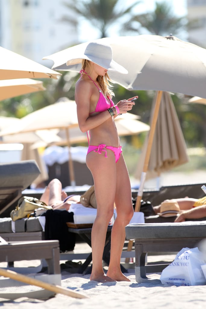 Birthday Girl Jessica Hart Lounges in Miami in a Hot Pink Bikini