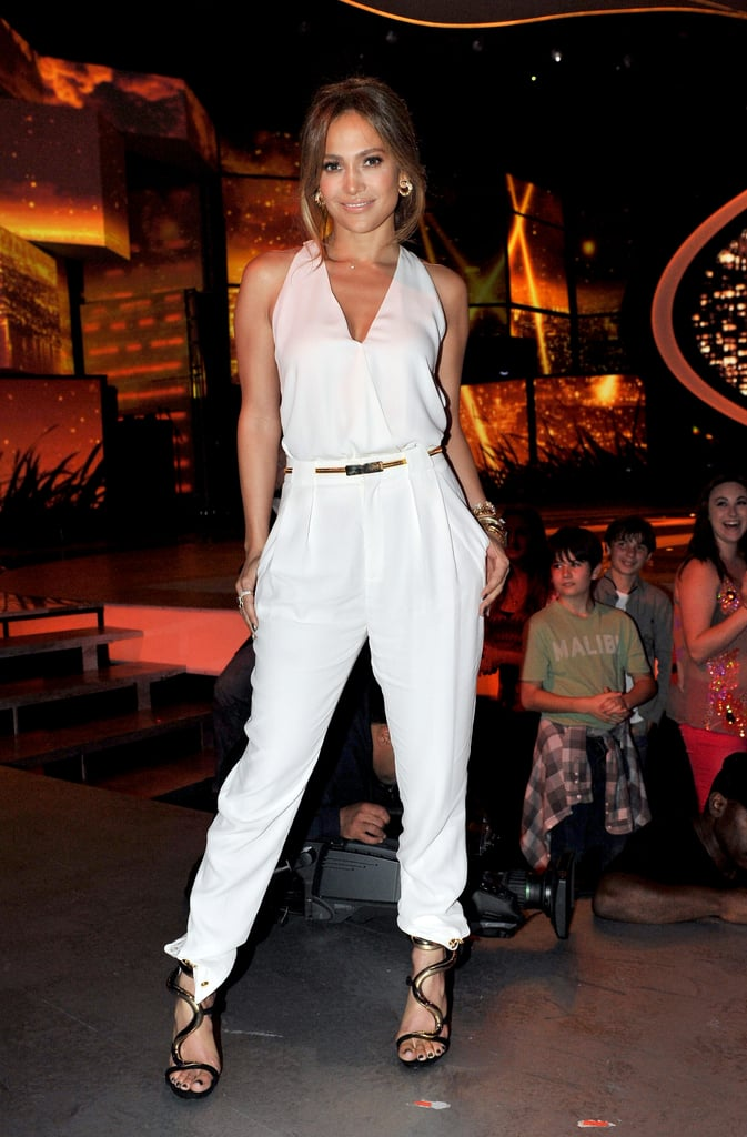 Here Jennifer opted for something more fresh, picking a white halter Gucci top with matching trousers, then finishing her glam look with wavy Giuseppe Zanotti sandals and gold Marina B baubles. We love the illusion that Jennifer is wearing a jumpsuit rather than separates.