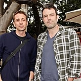 Ben Affleck posed with a friend at a charity poker tournament in LA.