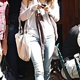 The ultimate mix of casual and dressy in light wash skinny jeans, peep-toe booties, and a long fringe scarf.