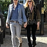 Kate Moss and husband Jamie Hince step out hand in hand in London.