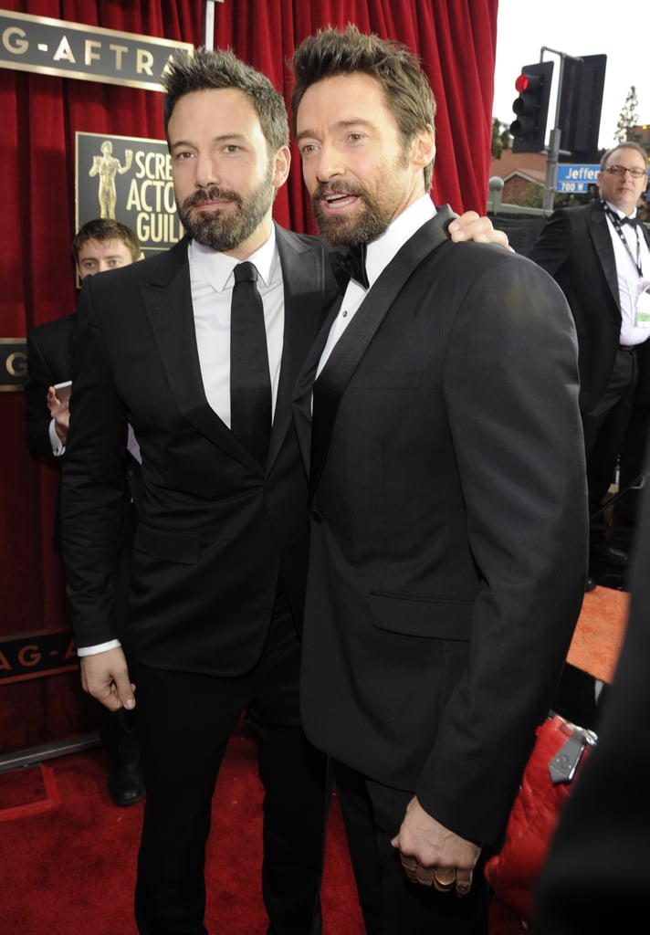 Ben Affleck and Hugh Jackman brought their movie-star smiles to the SAG Awards tonight in LA. Both Ben and Hugh suited up in dark looks for the big event and stopped to chat on the red carpet. Hugh has a big night ahead of him, as he is not only up for two SAG Awards — outstanding performance by a male actor in a leading role and outstanding performance by a cast for Les Misérables — but he will also be presenting at the event. Hugh took home the award for best actor in a musical or comedy at the Golden Globes earlier this month. Ben, meanwhile, is up for outstanding performance by a cast in a motion picture for Argo and brought wife Jennifer Garner to the show. Jennifer wore a gold, sequined gown after also showing support for Ben at the Producers Guild Awards last night.