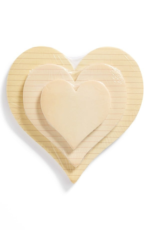 Jot down sweet nothings on heart-shaped Sticky Pads ($24 for set of 3) and leave them all over the house for your loved one to discover!
