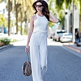 Halter neck white jumpsuits bring the style firmly into Summer 2018.