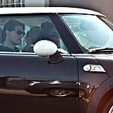 Katie Holmes and Tom Cruise kept a low profile, leaving an appointment in a Mini Cooper.