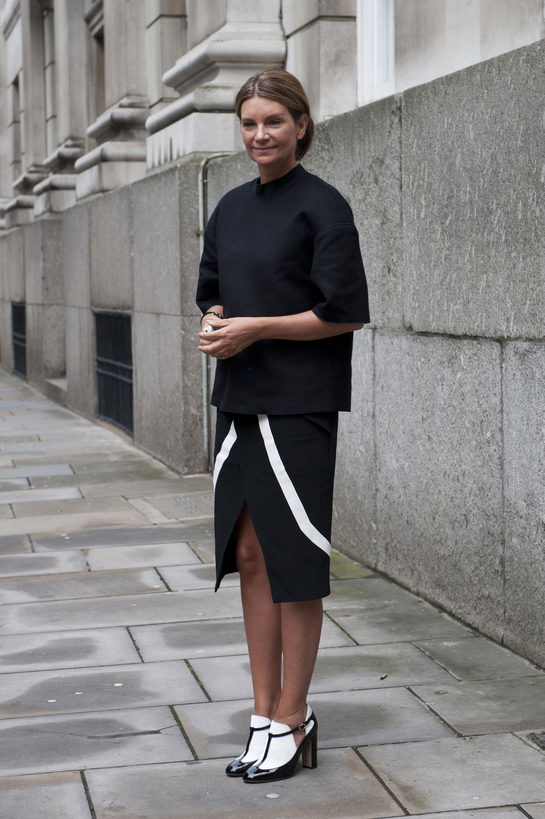 She fully committed to the black and white palette, right down to her Valentino heels.