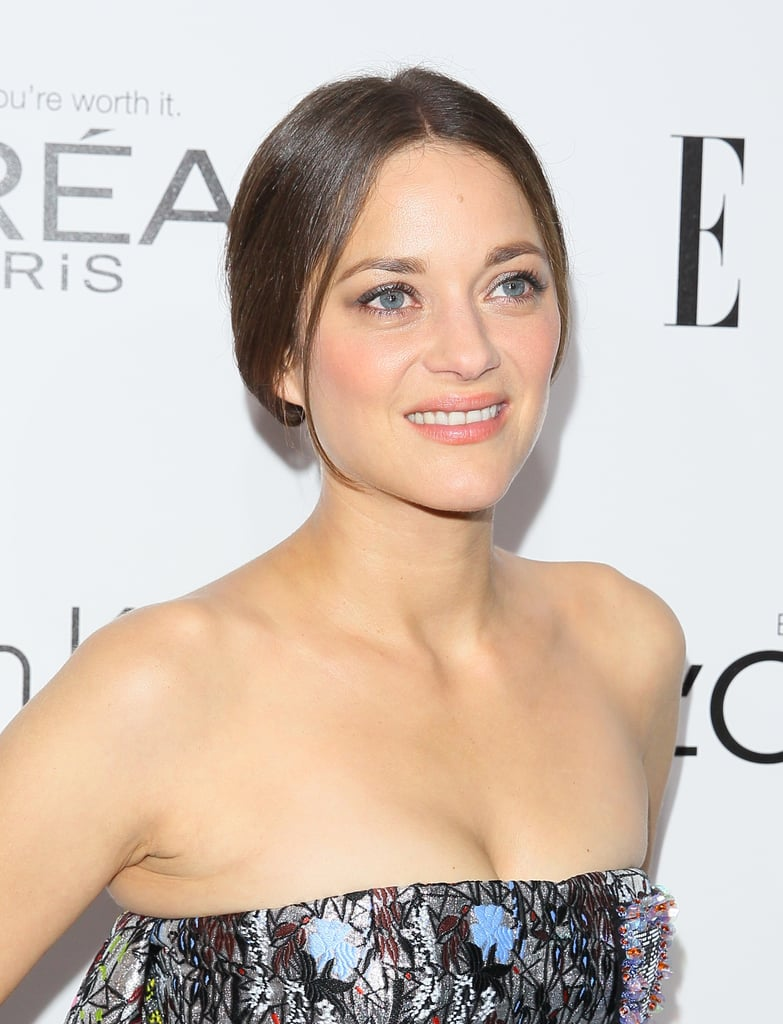 A nude makeup palette, loosely-tucked chignon, and gunmetal eyeliner made up the beauty look for Marion Cotillard.