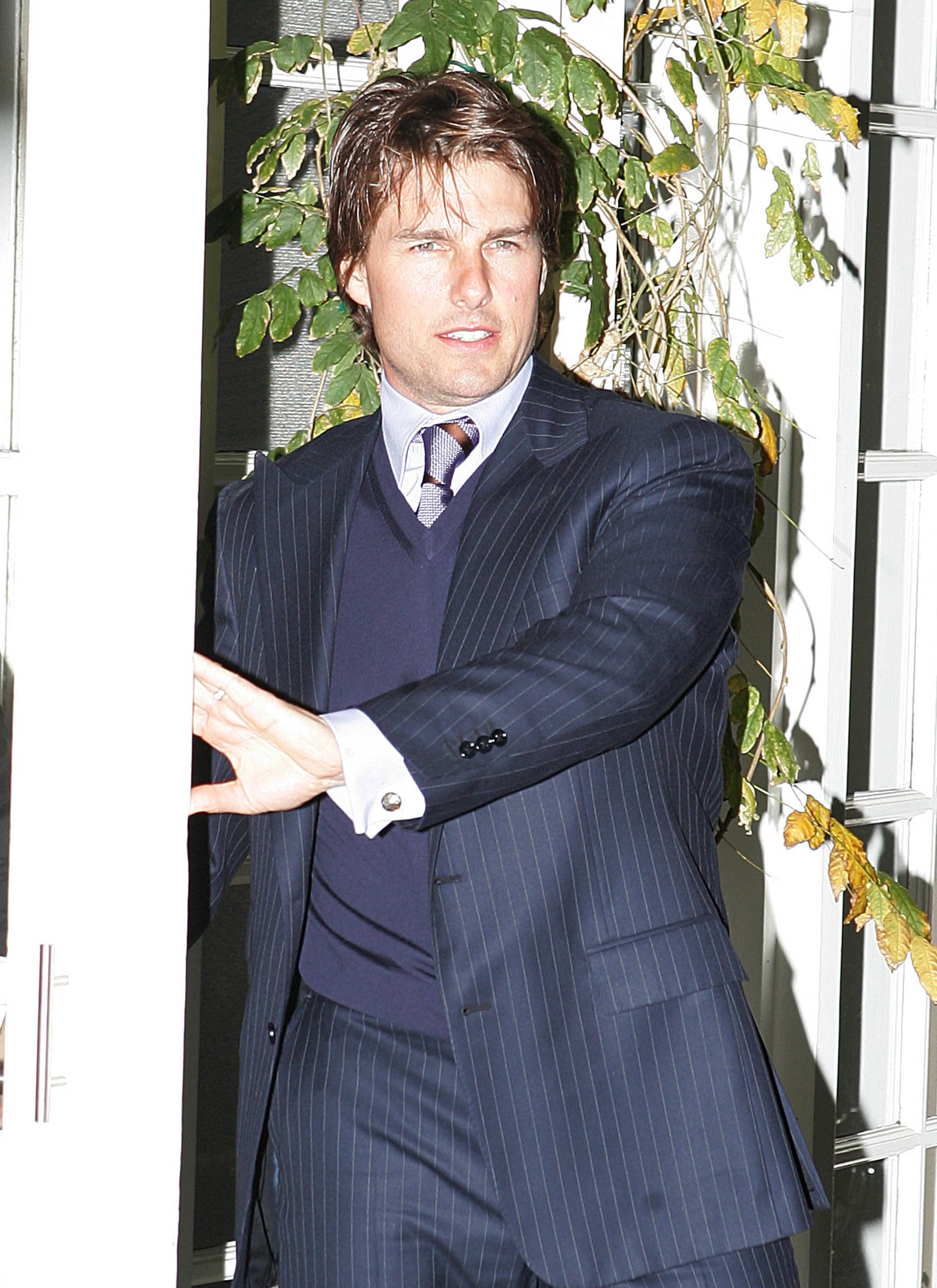 Tom Cruise got dressed up for dinner out in LA with Jennifer Lopez, Marc Anthony, and Victoria Beckham in December 2006.
