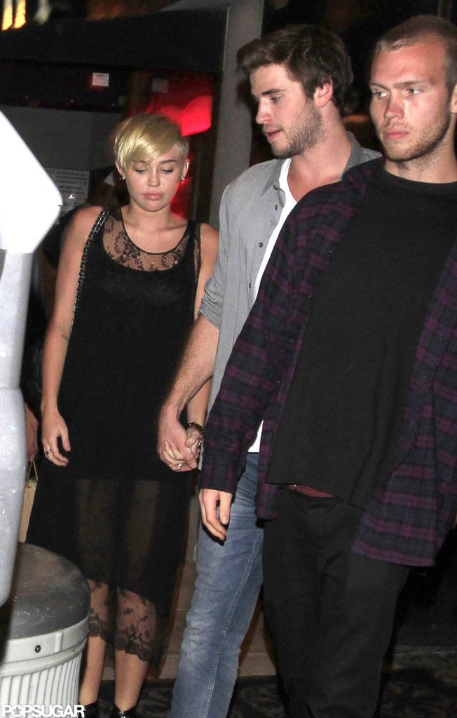 Miley Cyrus and Liam Hemsworth held hands during an outing to Troubadour in LA in Sept. 2012.