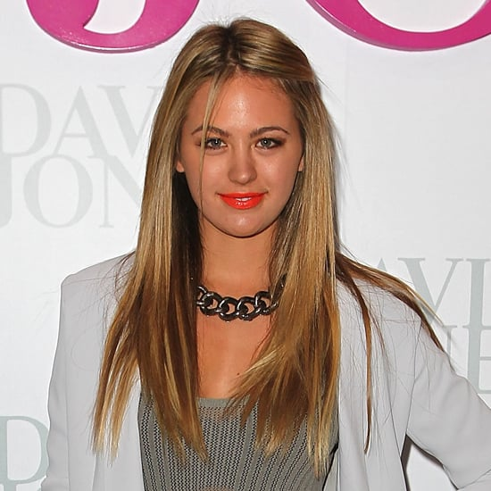Sleek hair with a pop of orange on the lip. We love! Keeping on top of the trends in August 2012.