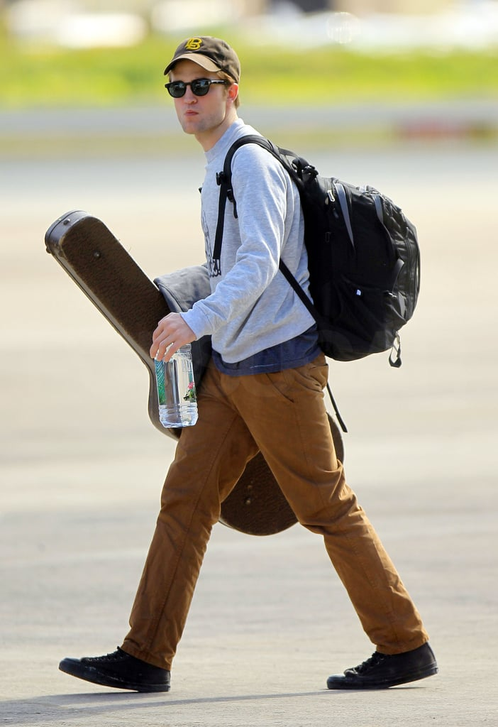 Robert Pattinson Leaves St. Thomas With His Guitar!