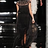 Since Channing Tatum is taking the stage to present an award during the ceremony, we're thinking this floaty black Reem Acra gown would look great on his pregnant wife, Jenna Dewan. The beaded neckline is fun yet sophisticated, and the empire waist would definitely flatter her baby bump.