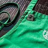 "Hearing Partners Who Are Fluent in ASL Wear ""I Sign"" Pins on Traditional Green Aprons"