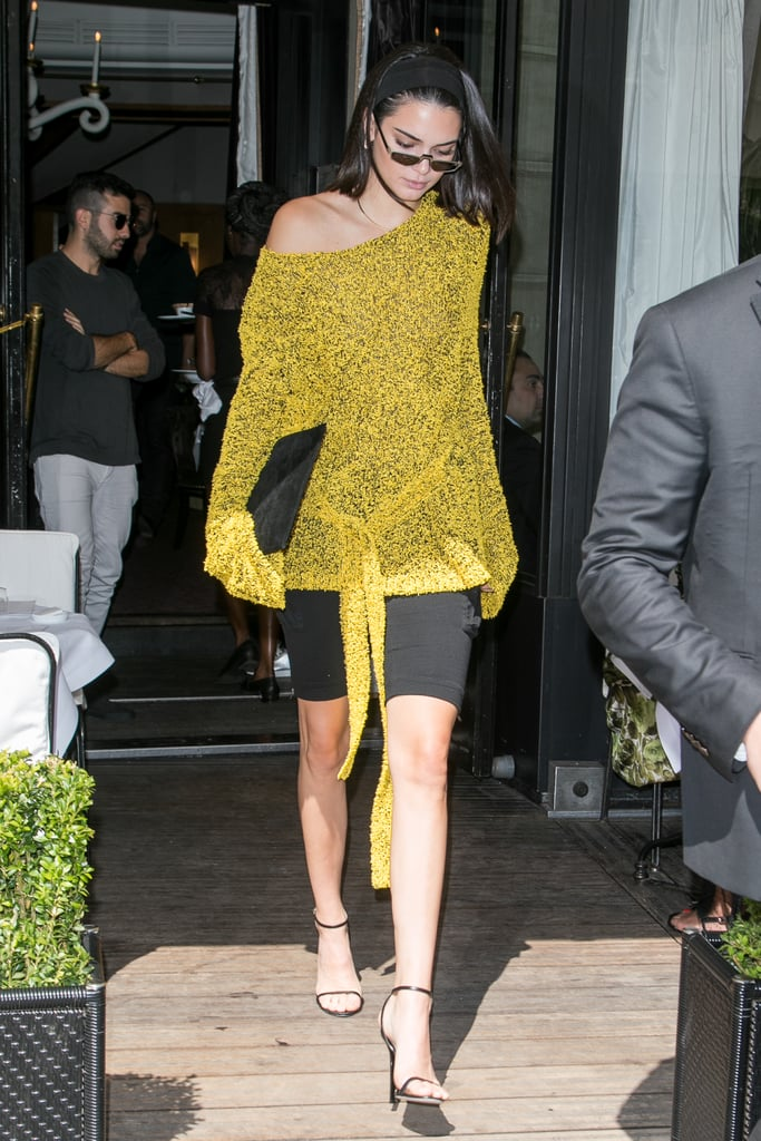 Kendall Wore a Fuzzy, Yellow Sweater by Dion Lee With Black Cargo Shorts From Vatanika
