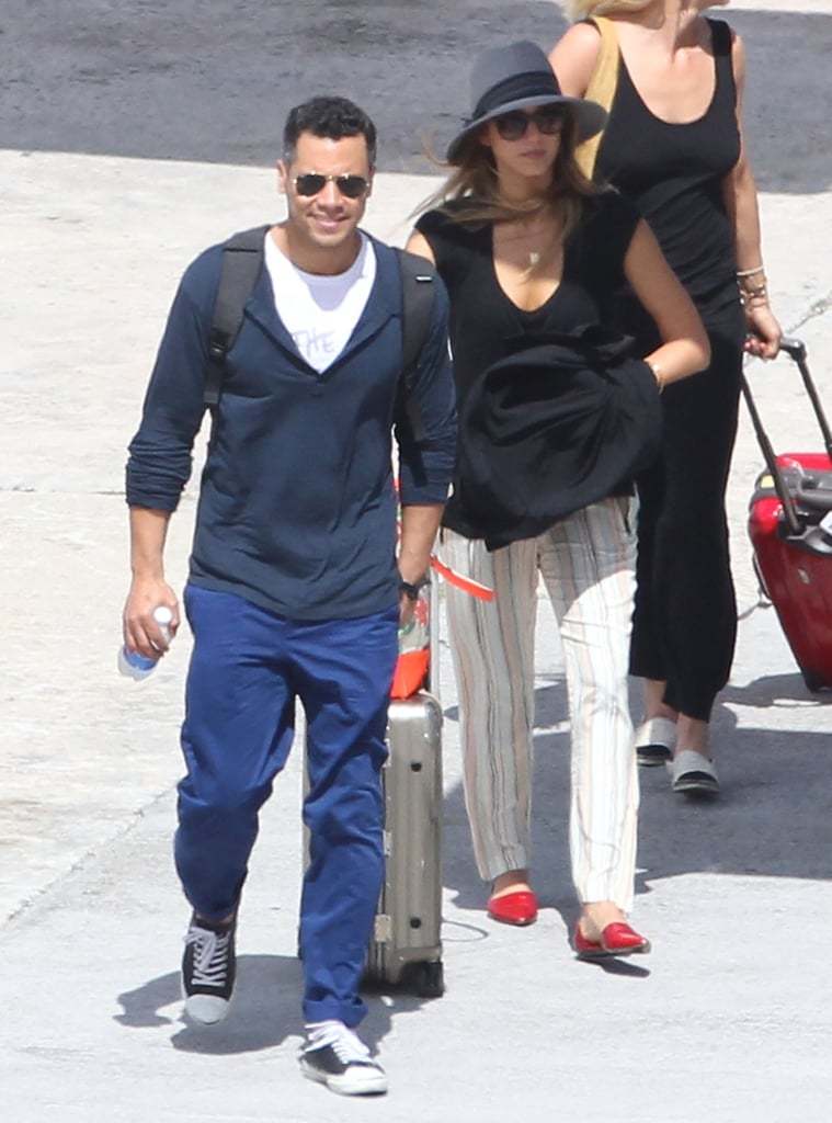 Jessica Alba and husband Cash Warren arrived in St. Barts looking cool in their respective vacation looks. Jessica paired these Rachel Zoe striped pants ($352) with red Jenni Kayne d'Orsay flats, then finished with a black tee and wide-brim hat.