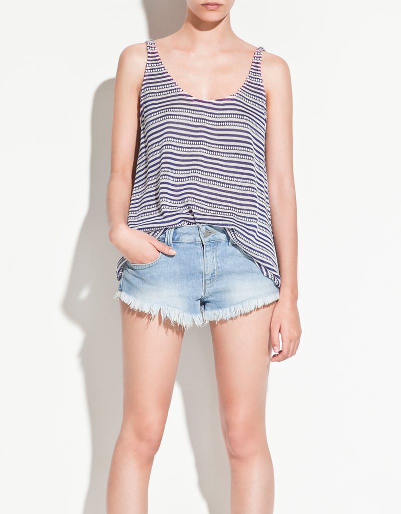 Zara's striped tank top ($26) is perfect for throwing over your bikini and shorts.