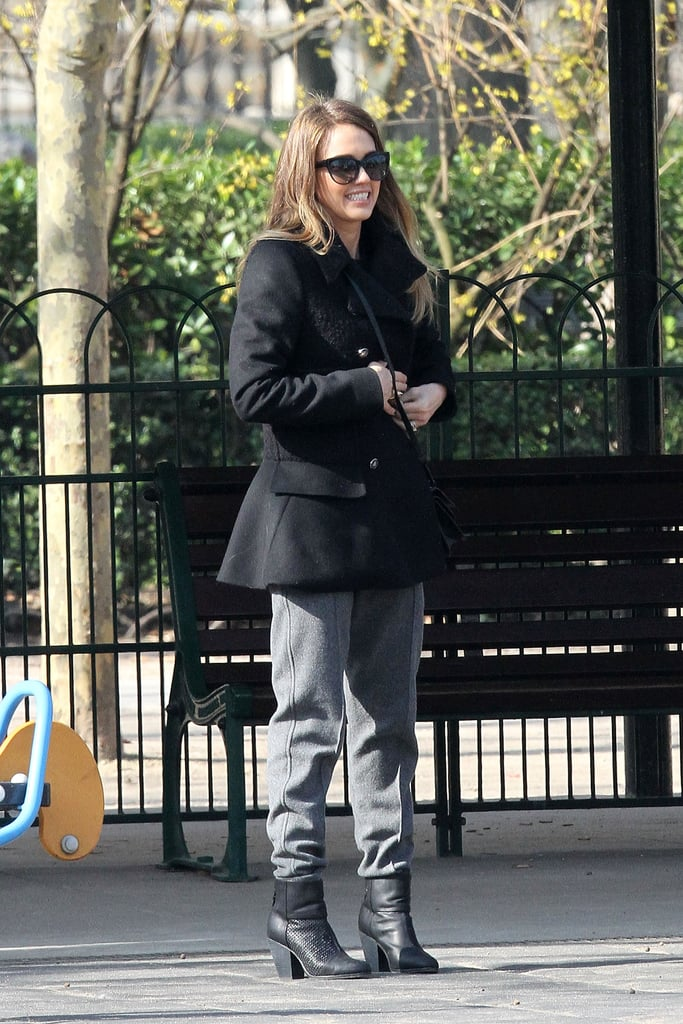 While logging some park time in Paris, Jessica donned a prim black peplum coat, loose-fitting pants, and perforated Rag & Bone ankle boots.