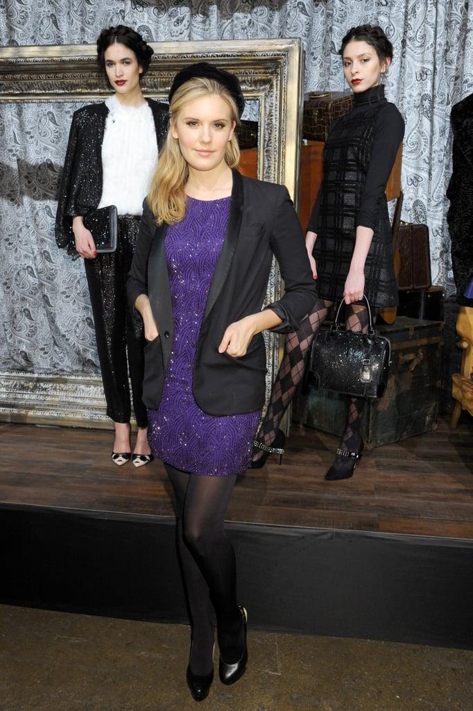 Maggie Grace looked Parisian chic in a purple Alice + Olivia minidress, a black tuxedo blazer, and a black beret at the designer's presentation.