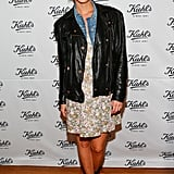 Leigh Lezark took an edgier route in a floral dress, a denim jacket, topped with a black leather jacket and finished with lace-up motorcycle boots.