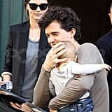 Orlando Bloom carries son Flynn Bloom to their car.