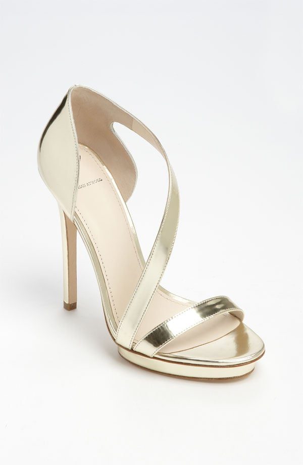 "Instead of opting for a traditional white heel, go for gold in this sleek metallic sandal. B Brian Atwood ""Consort"" Sandal ($325)"