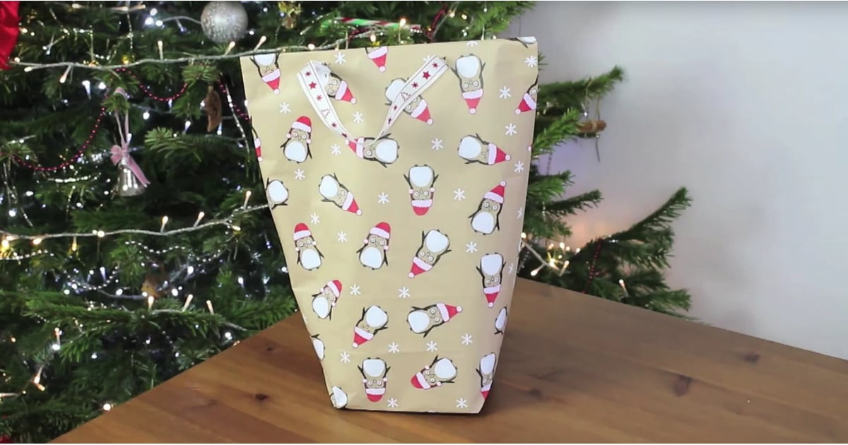 how to make a bag out of wrapping paper popsugar smart living. Black Bedroom Furniture Sets. Home Design Ideas