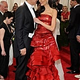 Amal attended the 2015 Met Gala in a strapless Maison Margiela gown by John Galliano.