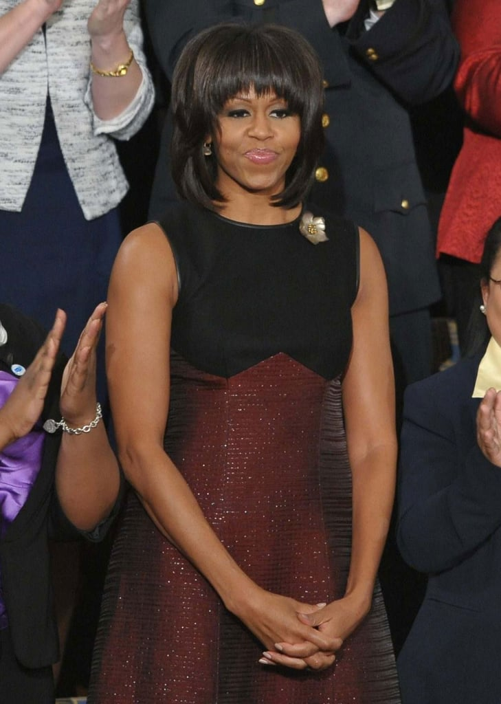 Michelle Obama chose designer Jason Wu again for the president's State of the Union address. Her sleeveless black-and-oxblood A-line dress showed off her form via an empire-waist silhouette, while the sparkly-meets-tweed finish gave her outfit an extra dose of flair.