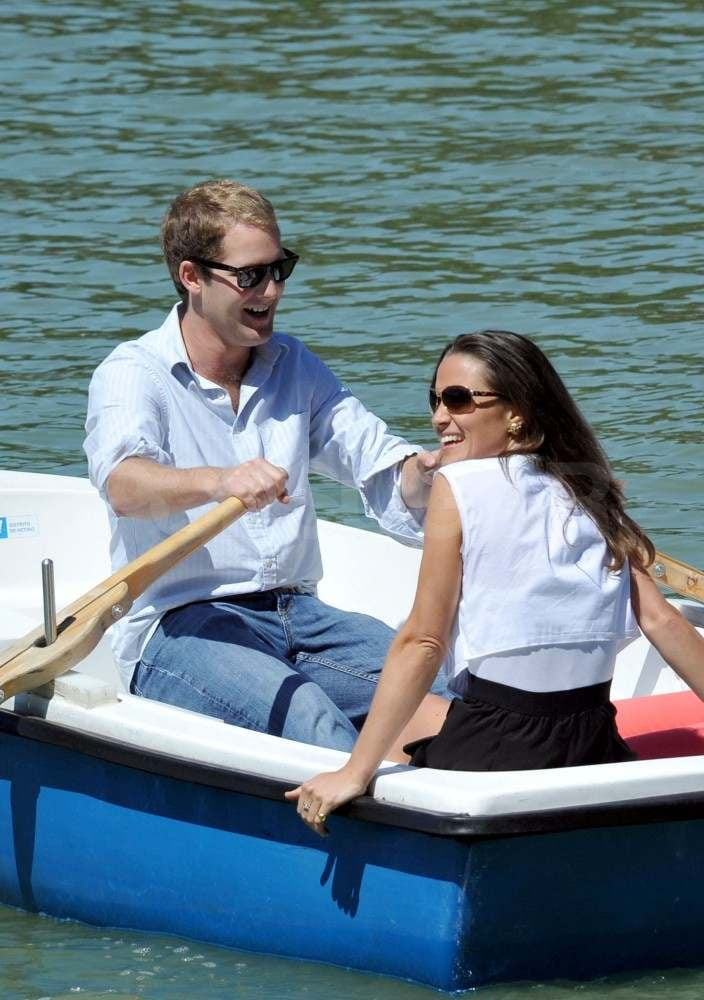 Pippa Middleton continued her vacation in Madrid with a relaxing boat ride yesterday. She lounged in the sun with a friend while George Percy took care of rowing duties. Pippa and George landed in Spain on Friday and were spotted out with pals that night, though Pippa's former boyfriend didn't join her for a shopping trip to Zara and ladies lunch on Saturday. Pippa and company wrapped up their day with a stop at a local cafe before heading to the airport to leave town together. Pippa's taking the spotlight while her sister Kate Middleton, the new Duchess of Cambridge, is on her honeymoon with Prince William. The newlyweds are on an exclusive island in the Seychelles, but will soon get back to royal duties that include a trip to Canada and the US this Summer. Kate and William will reportedly not travel with a large entourage, instead opting for a scaled back group that will most likely include about 10 aides. Absent from the list will be any ladies-in-waiting, since Kate has apparently decided to forgo the tradition in favor of taking care of her own needs.