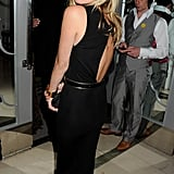 Kate Moss flashed her back at the Marie Curie Cancer Fundraiser at Claridge's.