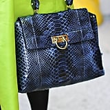 A reptilian-print satchel added a ladylike touch against a neon green skirt.