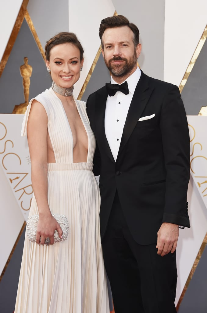 Olivia Wilde and Jason Sudeikis took the red carpet by storm on Monday as they arrived at the Oscars together. The couple posed together for photographers and Olivia, who steamed things up in a stunning low-cut Valentino Haute Couture gown, was positively glowing as she snapped shots solo. Olivia and Jason have been popping up at multiple high-profile events this award season, and most recently attended the NYC premiere of Jason's new film, Race. Keep reading to see Jason and Olivia's night at the Oscars, then check out all of their picture-perfect relationship moments.