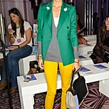 Olivia Palermo worked a bright, colorblocked look in yellow skinnies and a green blazer at Anya Hindmarch.