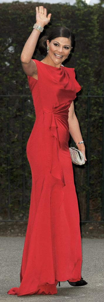 She Works a Sexy Red Gown and Makes It Feel Modest