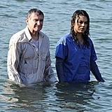Mila Kunis and Robin Williams stood in the water between takes.