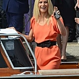 Gwyneth Paltrow waves hello with her BlackBerry.