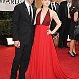 Amy Adams struck a pose alongside Darren Le Gallo at the Golden Globes.