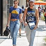 Steal Taylor Hill's easy West Coast look by knotting your favorite tee into a crop top, then wear with slouchy jeans and Birkenstocks.