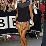 Another Phillip Lim piece, this time a sporty blue shell top, gave a lift to Cheryl's Alexander Wang leather miniskirt at the Radio 1 studios in 2014.