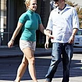 Britney Spears strut across the parking lot.