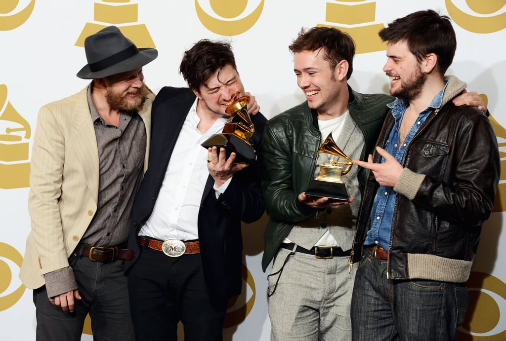Mumford & Sons celebrated their album of the year win in the press room.