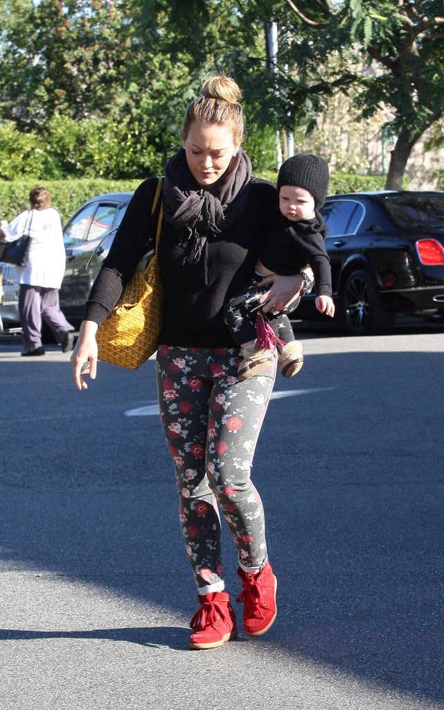 Hilary Duff walked with Luca Comrie in her arms.