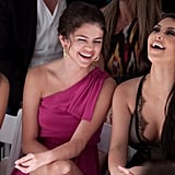 Selena Gomez and Kim Kardashian laughed in July 2010 at Miami Fashion Week.