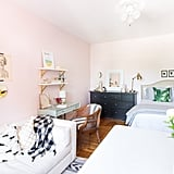 Blush-pink walls add a subtle warmth and lightness to the space that is at once feminine and elegant without feeling overly girlie.