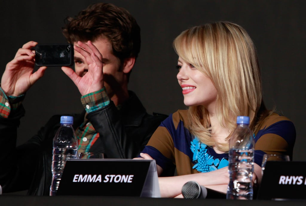 Andrew Garfield took pictures of the crowd with Emma Stone by his side at a press conference for The Amazing Spider-Man in Seoul.