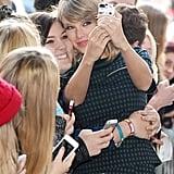 Taylor Swift took a selfie with a fan in London on Thursday.