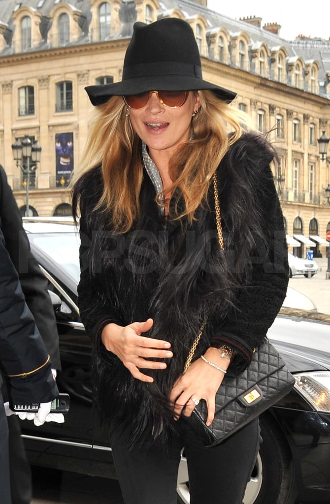 ">> Kate Moss was spotted wearing a brand-new diamond ring on her ring finger today — and although she's worn diamond rings on that finger in the past (and been rumored to be engaged a number of times before), The Sun is reporting that she plans to marry her boyfriend Jamie Hince on July 2. A spokesperson for Moss's agency, Storm Models, didn't deny the reports: ""We are making no comment. That may change later in the day, but at the moment there is no comment."" Apparently Hince, 40, proposed in bed on Tuesday night after Moss, 37, had turned out the lights to go to sleep, presenting her with a vintage 1920s engagement ring; Moss's daughter, Lila Grace Hack, is said to be acting as maid of honor. Moss and Hince were introduced by mutual friend Sadie Frost at one of his The Kills' gigs in September 2007."