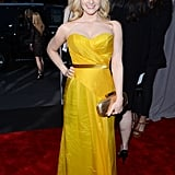 The Big Bang Theory's Melissa Rauch chose a saffron-yellow strapless gown and punched the look up further with a gold belt at the waist and a gold clutch.