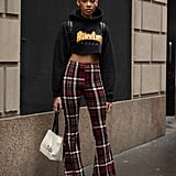 With a Cropped Graphic Hoodie and Flared Plaid Pants